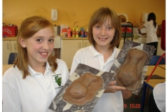 Students showing their pottery.