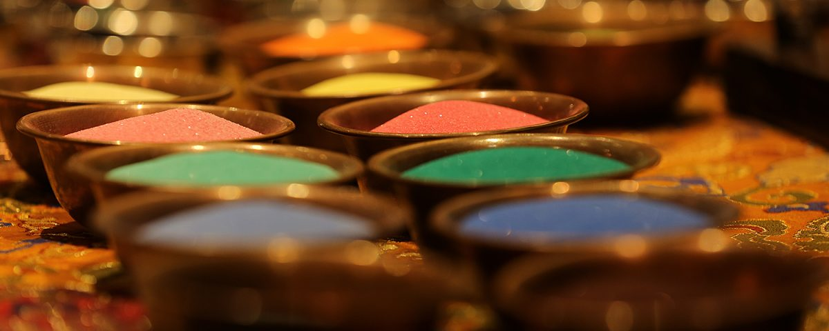 Sand waiting to be poured during the creation of a Sand Mandala. Tsering Choney Photography