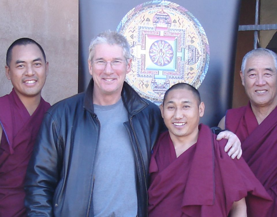 Richard Gere poses with monks from the Drepung Loseling Monastery at Seret & Sons Gallery