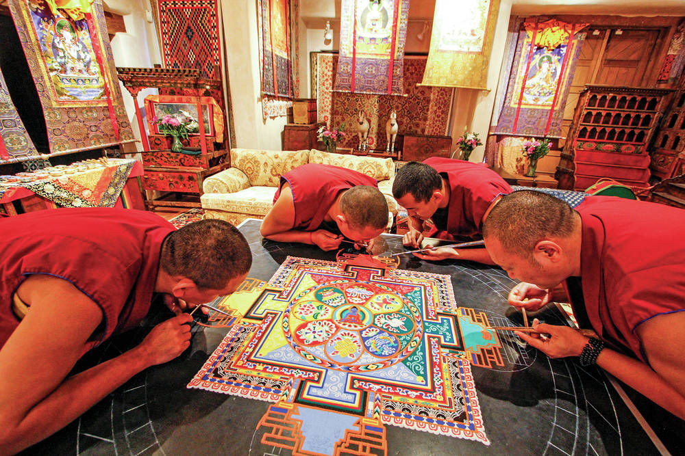 Monks of the Drepung Loseling Monastery pour millions of grains of sand to create a Sand Mandala at the Seret & Sons Gallery in Santa Fe, NM