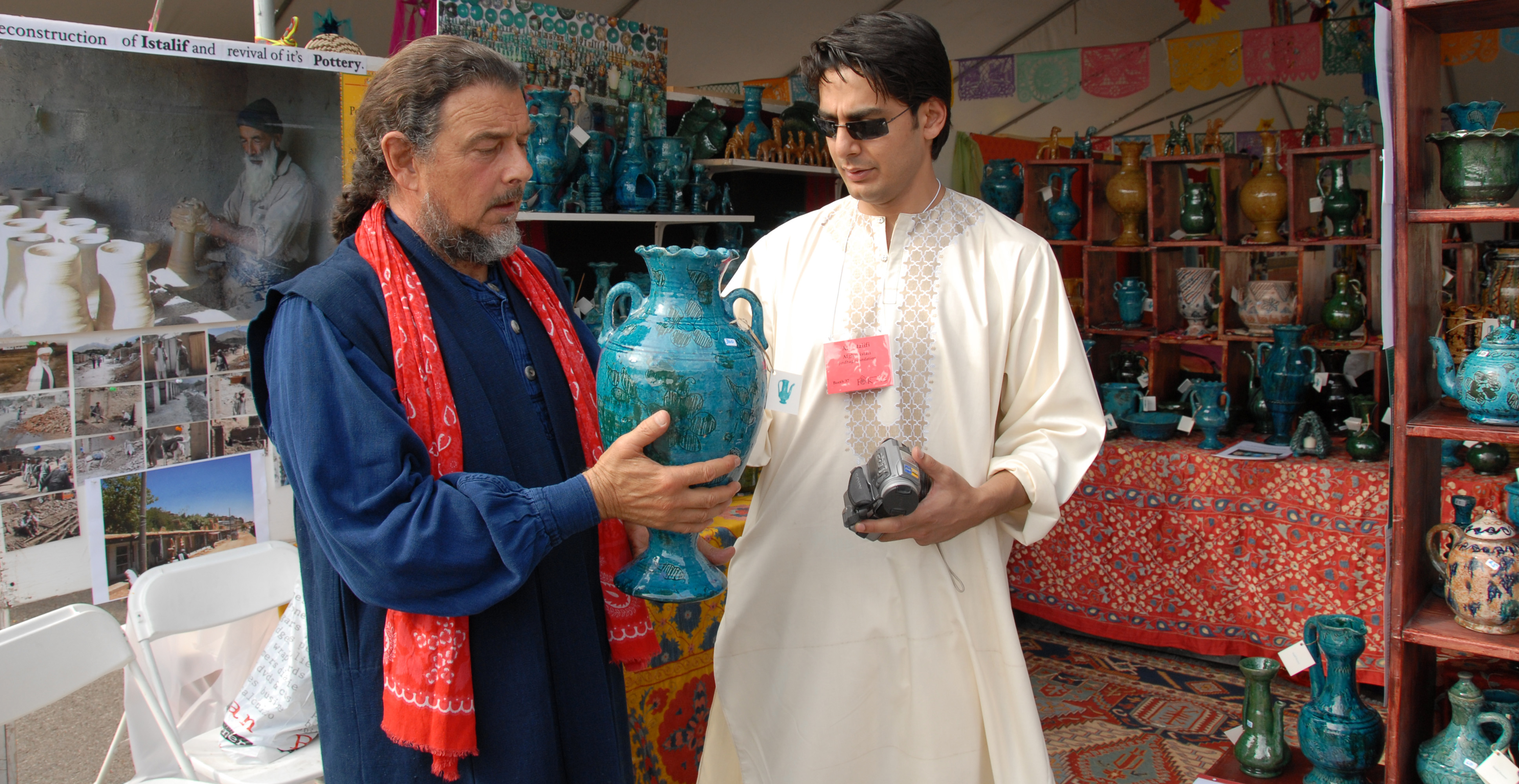 Ali Istalifi selling pottery at the International Folk Art Market in Santa Fe, NM