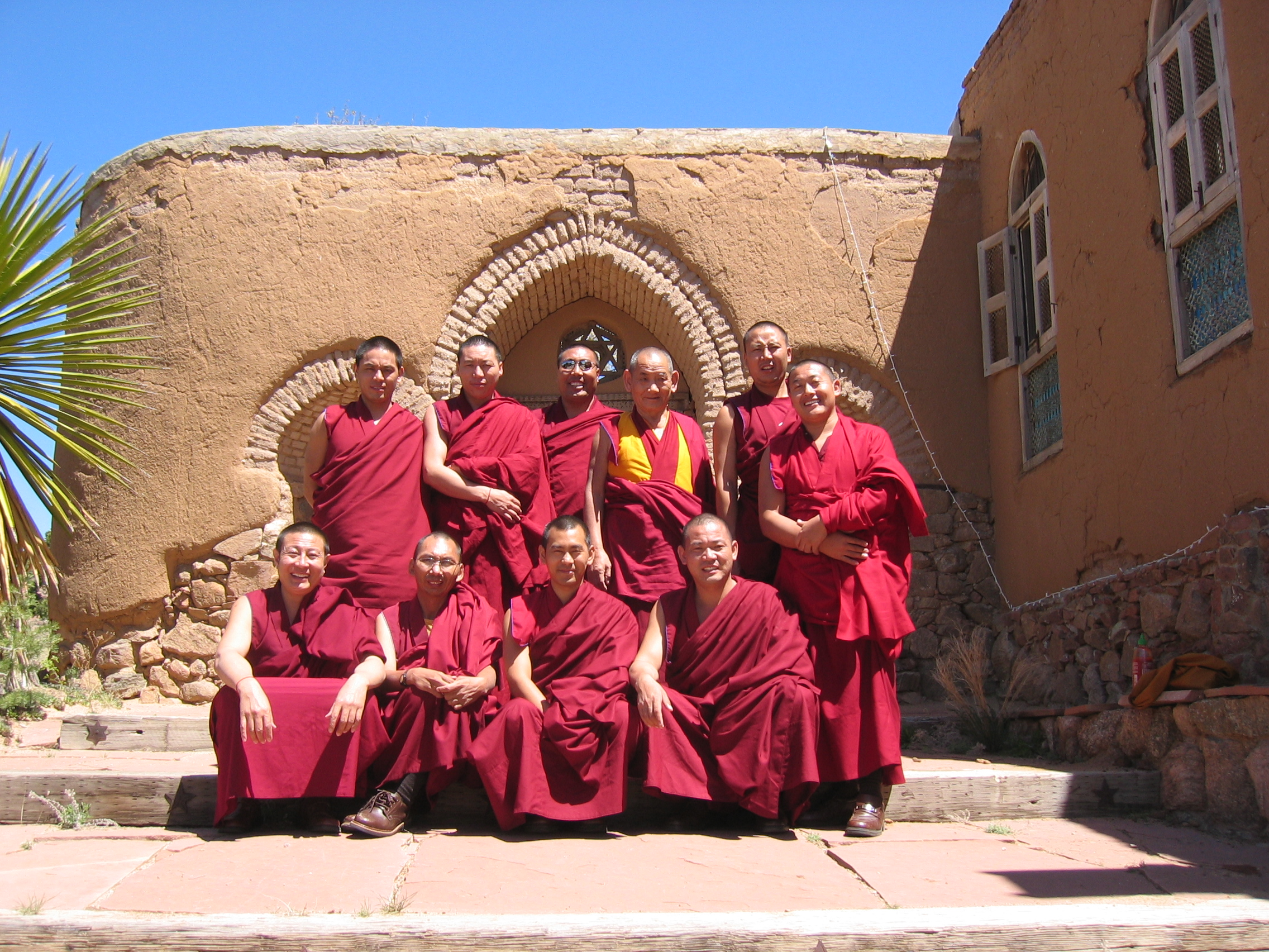 Monks from the Drepung Loseling Monastery pose for a photo after preforming a house blessing, Santa Fe, NM.