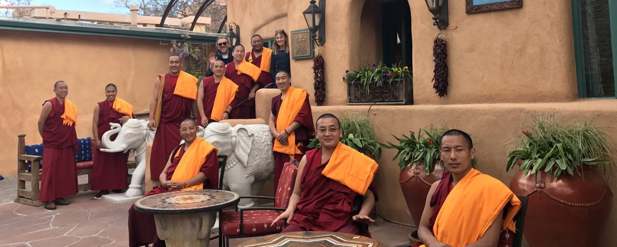 Monks from the Drepung Loseling Monastery pose for a photo after preforming a blessing ceremony at The Inn of The Five Graces in Santa Fe, NM.