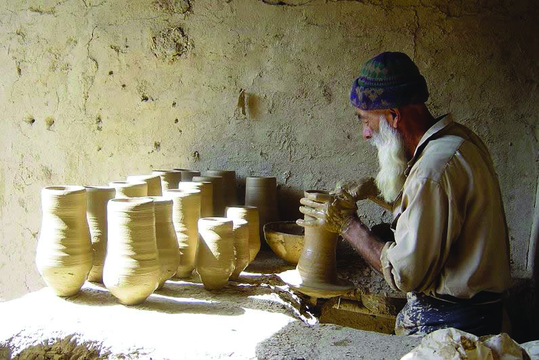 A potter throws pots on a wheel in Istalif, Afghanistan.